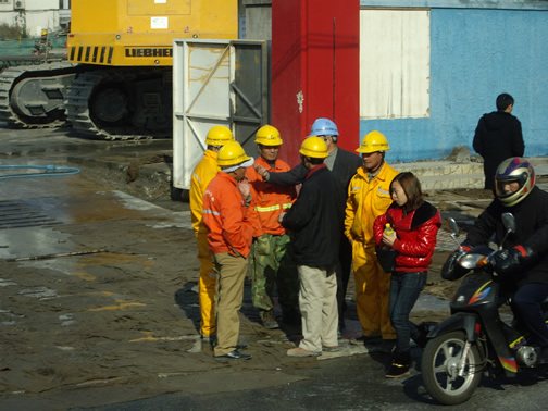 construction, people, and motor bikes